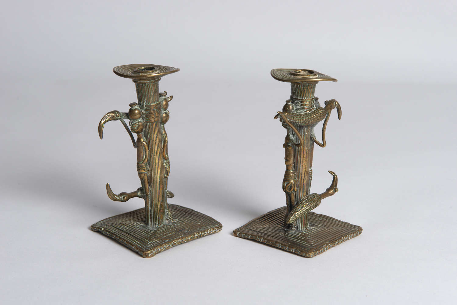 PAIR AFRICAN BRASS CANDLESTICKS